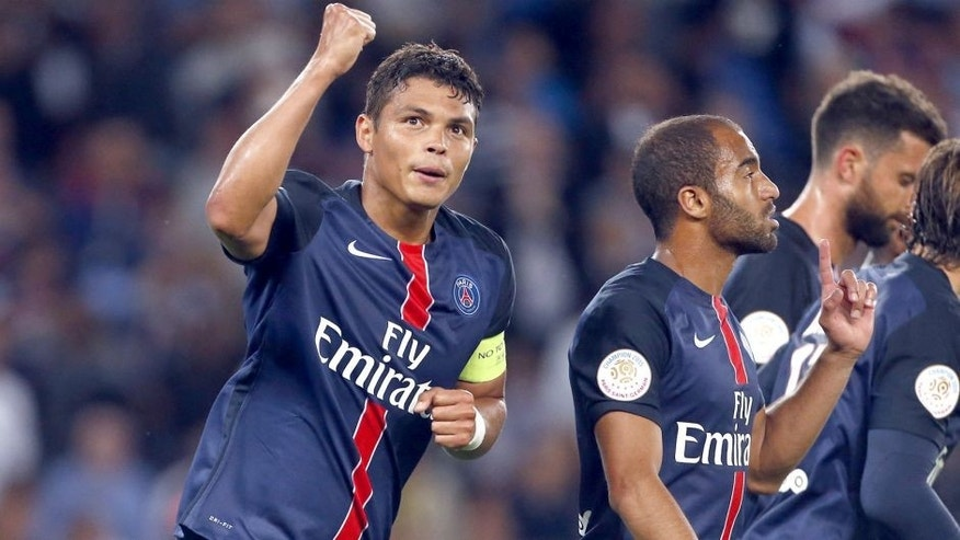 PARIS - AUGUST 16: Thiago Silva of PSG celebrates scoring a goal with Lucas Moura of PSG during the French Ligue 1 match between Paris Saint-Germain FC (PSG) and GFC Ajaccio (Gazelec Ajaccio) at Parc des Princes stadium on August 16, 2015 in Paris, France. (Photo by Jean Catuffe/Getty Images)