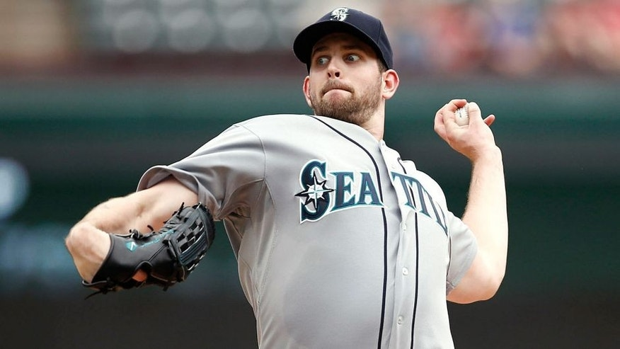 Sep 7, 2014; Arlington, TX, USA; Seattle Mariners starting pitcher James Paxton (65) delivers a pitch to the Texas Rangers during the third inning of a baseball game at Globe Life Park in Arlington. Mandatory Credit: Jim Cowsert-USA TODAY Sports