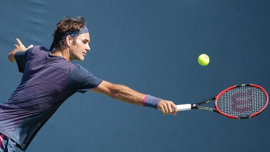 Roger Federer, of Switzerland, practices at the Western & Southern Open tennis tournament, Sunday, Aug. 16, 2015, in Mason, Ohio. (AP Photo/John Minchillo)