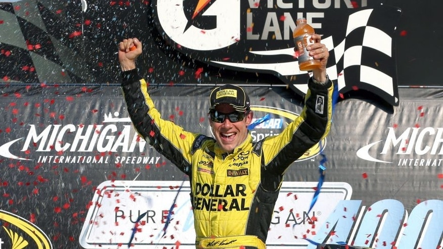 BROOKLYN, MI - AUGUST 16: Matt Kenseth, driver of the #20 Dollar General Toyota, celebrates in victory lane after winning the NASCAR Sprint Cup Series Pure Michigan 400 at Michigan International Speedway on August 16, 2015 in Brooklyn, Michigan. (Photo by Nick Laham/NASCAR via Getty Images)