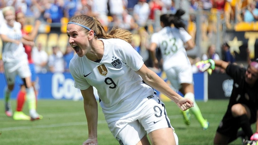 United States midfielder Heather O'Reilly (9) celebrates after scoring a goal against Costa Rica during the first half of a women's friendly soccer match on Sunday, Aug. 16, 2015, in Pittsburgh. (AP Photo/Don Wright)