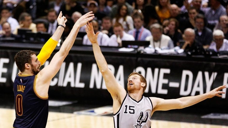 Mar 12, 2015; San Antonio, TX, USA; Cleveland Cavaliers forward Kevin Love (0) shoots the ball over San Antonio Spurs power forward Matt Bonner (15) during the first half at AT&T Center. Mandatory Credit: Soobum Im-USA TODAY Sports