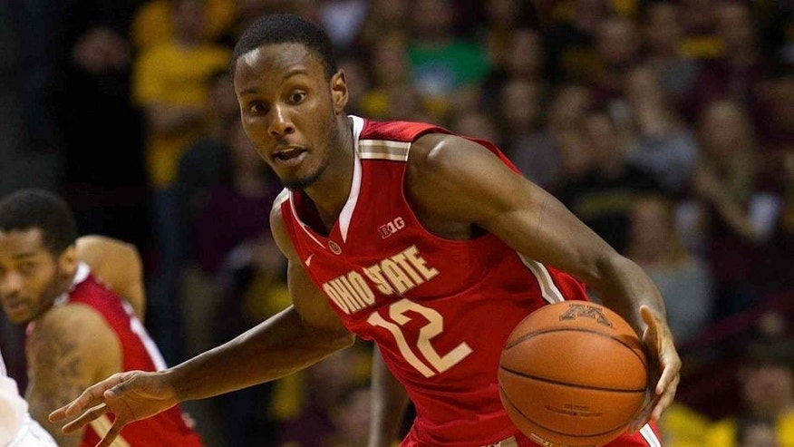 <p>Jan 16, 2014; Minneapolis, MN, USA; Ohio State Buckeyes forward Sam Thompson (12) dribbles in the first half against the Minnesota Gophers at Williams Arena. </p>