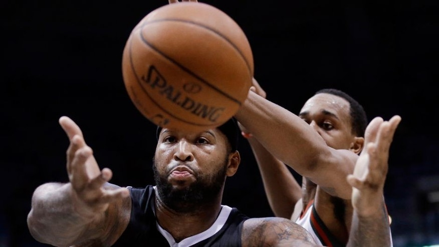 <p>Sacramento Kings' DeMarcus Cousins and Milwaukee Bucks' John Henson go after a loose ball during the first half of an NBA basketball game Wednesday, Feb. 11, 2015, in Milwaukee. (AP Photo/Morry Gash)</p>