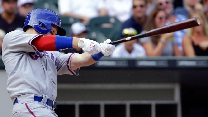 RETRANSMISSION TO CORRECT YEAR - Chicago Cubs' Chris Coghlan hits a solo home run during the fifth inning of an interleague baseball game against the Chicago White Sox Friday, Aug. 14, 2015, in Chicago. (AP Photo/Nam Y. Huh)