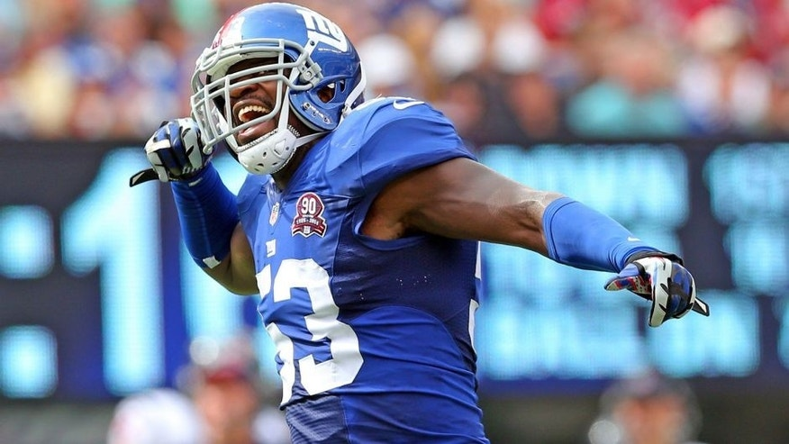 Sep 21, 2014; East Rutherford, NJ, USA; New York Giants outside linebacker Jameel McClain (53) reacts against the Houston Texans during the third quarter at MetLife Stadium. Mandatory Credit: Brad Penner-USA TODAY Sports