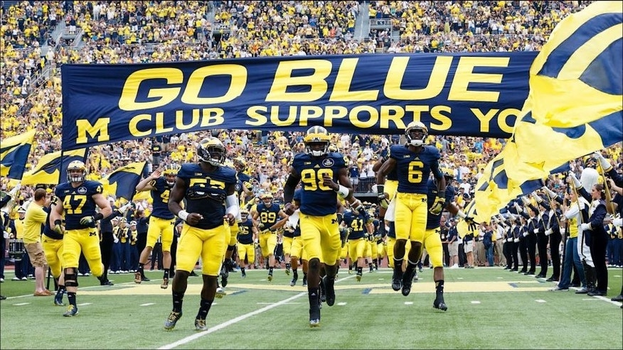 <p>Aug 30, 2014; Ann Arbor, MI, USA; Michigan Wolverines quarterback Devin Gardner (98) leads the team onto the field before the game against the Appalachian State Mountaineers at Michigan Stadium. Mandatory Credit: Rick Osentoski-USA TODAY Sports</p>