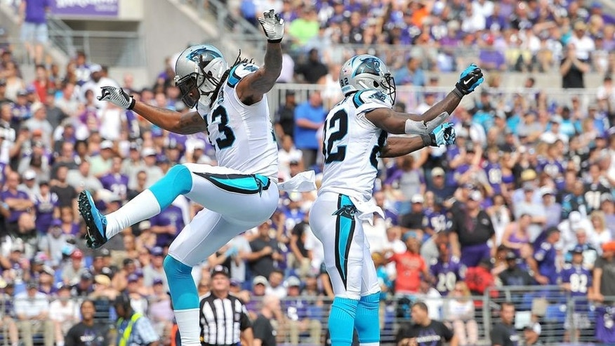 BALTIMORE, MD - SEPTEMBER 28: Wide receiver Kelvin Benjamin #13 of the Carolina Panthers celebrates with wide receiver Jerricho Cotchery #82 of the Carolina Panthers after scoring a touchdown in the second hafl of a game against the Baltimore Ravens at M&T Bank Stadium on September 28, 2014 in Baltimore, Maryland. (Photo by Larry French/Getty Images)