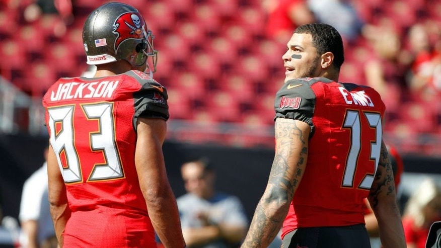 Nov 30, 2014; Tampa, FL, USA; works Tampa Bay Buccaneers wide receiver Mike Evans (13) and wide receiver Vincent Jackson (83) talk prior to the game against the Cincinnati Bengals at Raymond James Stadium. Mandatory Credit: Kim Klement-USA TODAY Sports