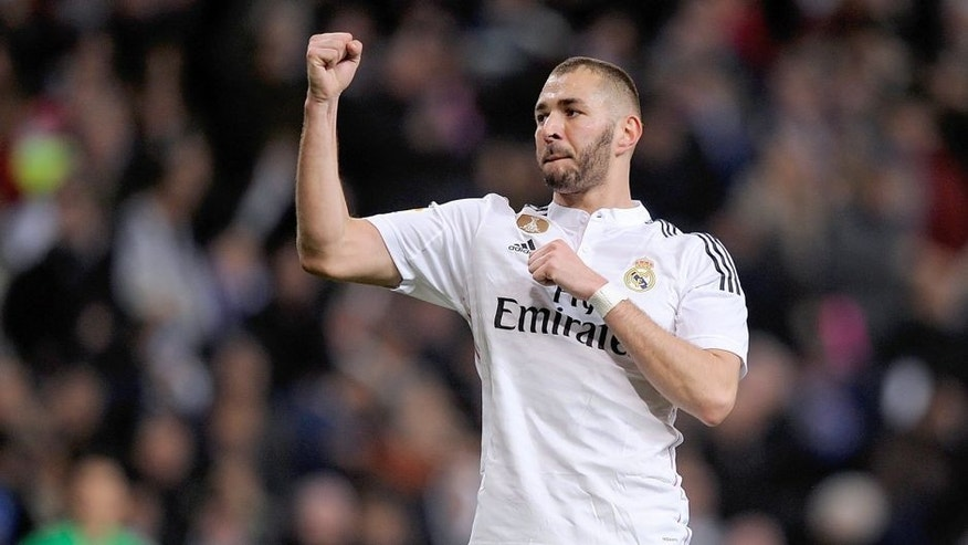 MADRID, SPAIN - FEBRUARY 15: Karim Benzema of Real Madrid celebrates after scoring Real's 2nd goal during the La Liga match between Real Madrid CF and RC Deportivo La Coruna at Estadio Santiago Bernabeu on February 15, 2015 in Madrid, Spain. (Photo by Denis Doyle/Getty Images)