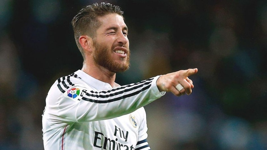 MADRID, SPAIN - NOVEMBER 08: Sergio Ramos of Real Madrid CF celebrates scoring their second goal during the La Liga match between Real Madrid CF and Rayo Vallecano de Madrid at Estadio Santiago Bernabeu on November 8, 2014 in Madrid, Spain. (Photo by Gonzalo Arroyo Moreno/Getty Images)