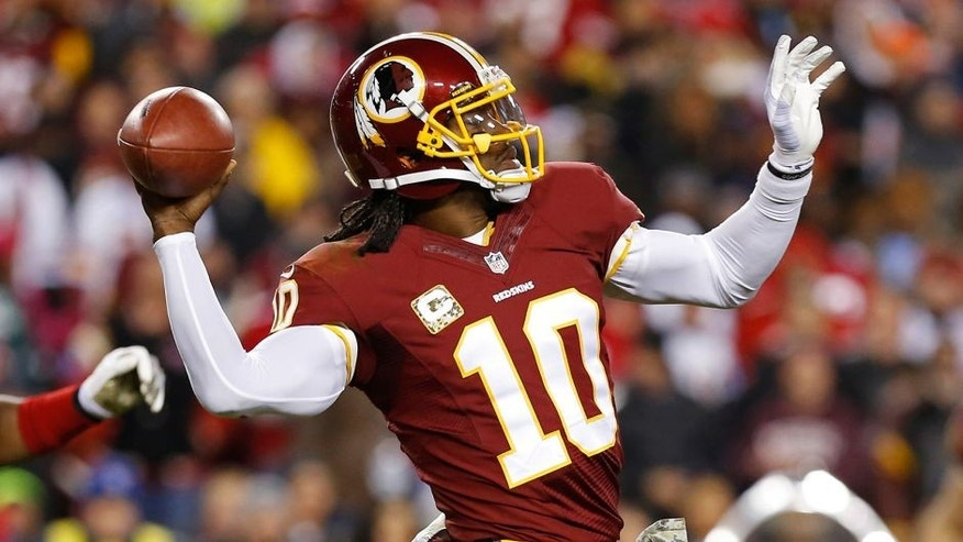 Nov 25, 2013; Landover, MD, USA; Washington Redskins quarterback Robert Griffin III (10) throws the ball against the San Francisco 49ers at FedEx Field. Mandatory Credit: Geoff Burke-USA TODAY Sports