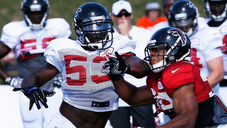 Atlanta Falcons linebacker Prince Shembo (53) works against Atlanta Falcons running back Josh Vaughan (30) during an NFL football training camp Monday, July 28, 2014, in Flowery Branch, Ga. (AP Photo/John Bazemore)