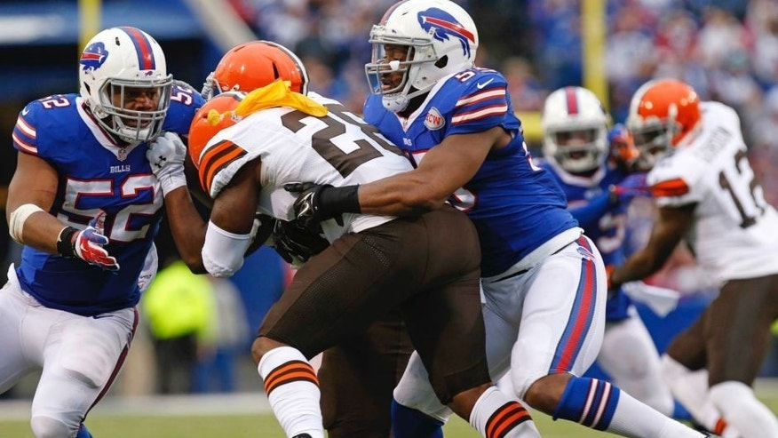 <p>Buffalo Bills defensive end Jerry Hughes (55) tackles Cleveland Browns running back Terrance West (28) causing a fumble which Hughes recovers to score a touchdown during the second half at Ralph Wilson Stadium.</p>