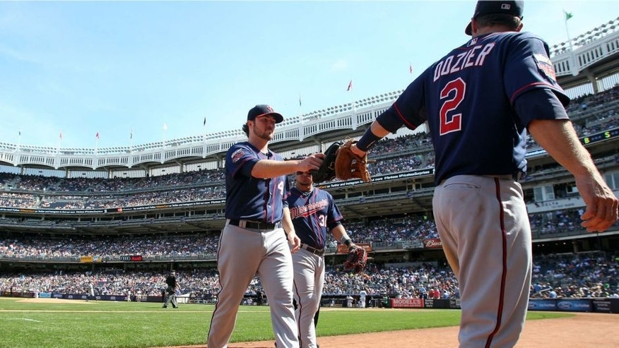 <p>Jun 1, 2014; Bronx, NY, USA; Minnesota Twins starting pitcher Phil Hughes (45) is congratulated by Twins second baseman Brian Dozier (2) as he walks off the mound after the eighth inning of a game against the New York Yankees at Yankee Stadium. The Twins defeated the Yankees 7-2. Mandatory Credit: Brad Penner-USA TODAY Sports</p>
