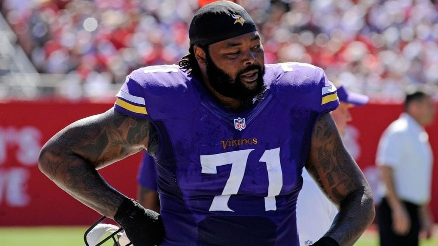 <p>Oct 26, 2014; Tampa, FL, USA; Minnesota Vikings tackle Phil Loadholt (71) walks on the sidelines against the Tampa Bay Buccaneers at Raymond James Stadium. Mandatory Credit: David Manning-USA TODAY Sports</p>