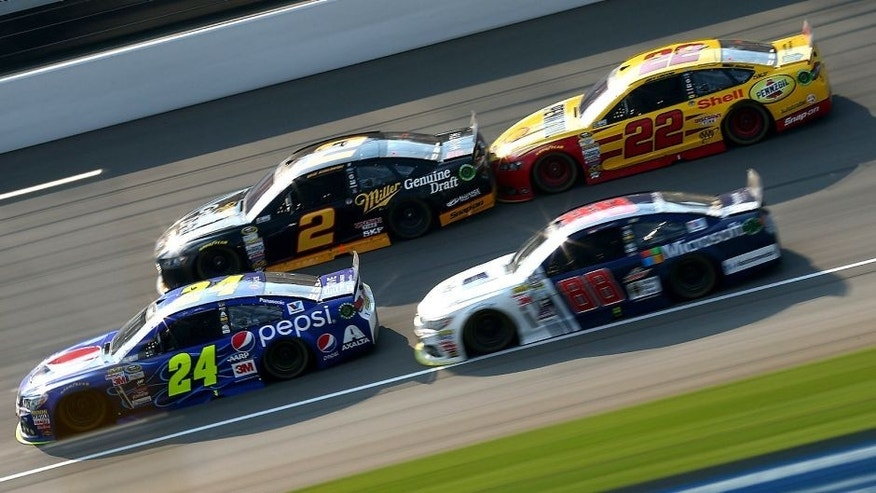 BROOKLYN, MI - AUGUST 16: Jeff Gordon, driver of the #24 Pepsi Chevrolet, Dale Earnhardt Jr., driver of the #88 Microsoft Chevrolet, Brad Keselowski, driver of the #2 Miller Lite Ford, and Joey Logano, driver of the #22 Shell Pennzoil Ford, race during the NASCAR Sprint Cup Series Pure Michigan 400 at Michigan International Speedway on August 16, 2015 in Brooklyn, Michigan. (Photo by Sarah Crabill/Getty Images)