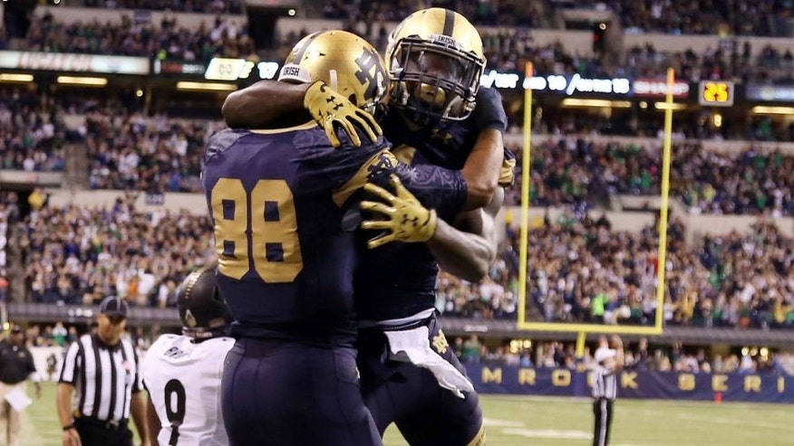 Sep 13, 2014; Indianapolis, IN, USA; Notre Dame Fighting Irish wide receiver Corey Robinson (88) celebrates with wide receiver Chris Brown (1) after scoring a touchdown against the Purdue Boilermakers at Lucas Oil Stadium. Notre Dame defeats Purdue 30-14. Mandatory Credit: Brian Spurlock-USA TODAY Sports