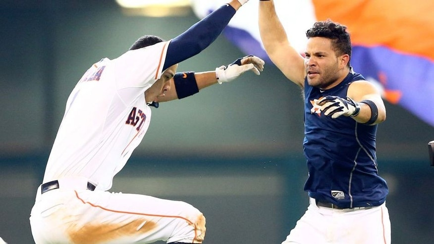 Aug 16, 2015; Houston, TX, USA; Houston Astros second baseman Jose Altuve (right) celebrates with shortstop Carlos Correa after hitting a walk off single against the Detroit Tigers at Minute Maid Park. The Astros defeated the Tigers 6-5. Mandatory Credit: Mark J. Rebilas-USA TODAY Sports