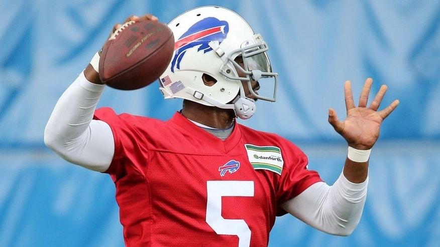 May 26, 2015; Orchard Park, NY, USA; Buffalo Bills quarterback Tyrod Taylor (5) throws a pass during the organized team activities at the ADPRO Sports Training Center. Mandatory Credit: Kevin Hoffman-USA TODAY Sports
