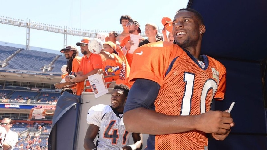 Aug 2, 2014; Denver, CO, USA; Denver Broncos wide receiver Emmanuel Sanders (10) leaves the field following a scrimmage at Sports Authority Field. Mandatory Credit: Ron Chenoy-USA TODAY Sports