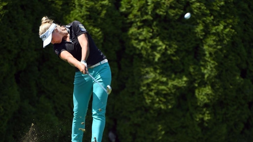 Brooke M. Henderson of Canada hits her tee shot on the on the eighth hole during the final round of the Cambia Portland Classic golf tournament in Portland, Ore., Sunday, Aug. 16, 2015. (AP Photo/Steve Dykes)