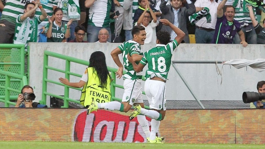 LISBON, PORTUGAL - AUGUST 18: Sporting's forward Teofilo Gutierrez celebrates scoring a goal with Sporting's forward Andre Carrillo during the UEFA Champions League qualifying round play-off first leg match between Sporting CP and CSKA Moscow at Estadio Jose Alvalade on August 18, 2015 in Lisbon, Portugal. (Photo by Carlos Rodrigues/Getty Images)