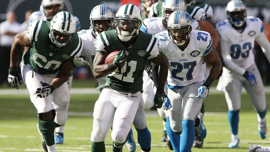 Sep 28, 2014; East Rutherford, NJ, USA; New York Jets running back Chris Johnson (21) carries the ball to score a touchdown in the second half against the Detroit Lions at MetLife Stadium. Mandatory Credit: Noah K. Murray-USA TODAY Sports