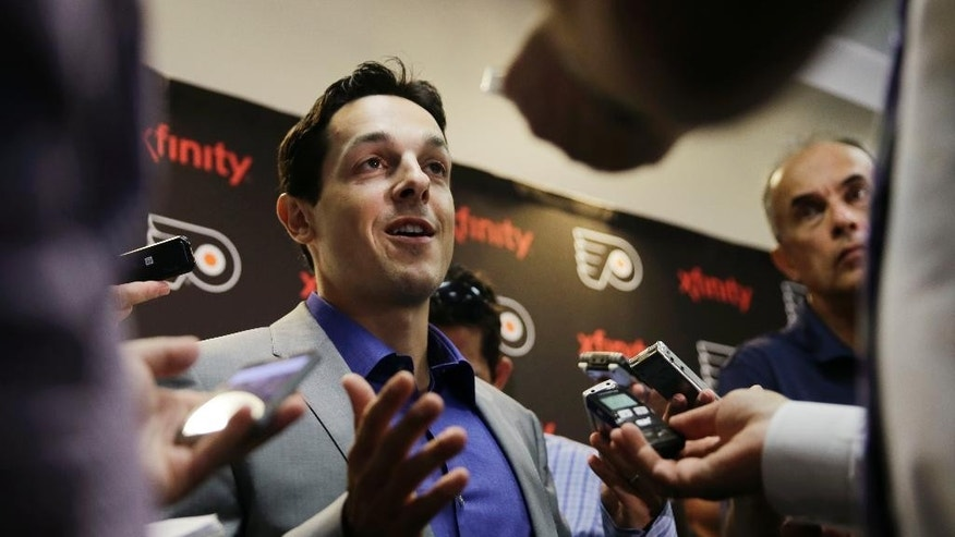 Danny Briere speaks during a news conference Tuesday, Aug. 18, 2015, in Voorhees, N.J.  Briere, the undersized center who went on to become an NHL All-Star and keyed the Philadelphia Flyers' run to the 2010 Stanley Cup Finals, has retired. Briere ended a 17-year career on Monday, that saw him play for the Phoenix Coyotes, Buffalo Sabres, Flyers, Montreal Canadiens and Colorado Avalanche. (AP Photo/Matt Rourke)