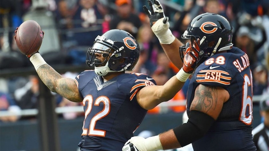 Oct 19, 2014; Chicago, IL, USA; Chicago Bears running back Matt Forte (22) reacts after a touchdown during the second half at Soldier Field. Miami Dolphins defeat the Chicago Bears 27-14. Mandatory Credit: Mike DiNovo-USA TODAY Sports