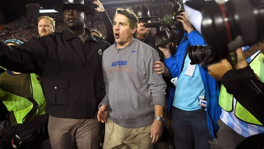 Nov 29, 2014; Tallahassee, FL, USA; Florida Gators head coach Will Muschamp walks off the field after the game at Doak Campbell Stadium. Florida State Seminoles defeated Florida Gators 24-19. Mandatory Credit: Tommy Gilligan-USA TODAY Sports