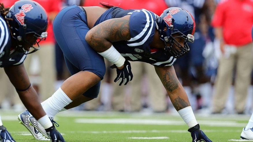 Sep 13, 2014; Oxford, MS, USA; Mississippi Rebels defensive tackle Robert Nkemdiche (5) steps up to the line during the game against the Louisiana-Lafayette Ragin Cajuns at Vaught-Hemingway Stadium. Mandatory Credit: Spruce Derden-USA TODAY Sports