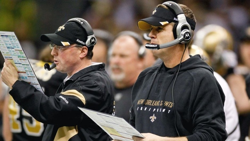 January 1, 2012; New Orleans, LA, USA; New Orleans Saints head coach Sean Payton and offensive coordinator Pete Carmichael on the sideline during the third quarter of a game against the Carolina Panthers at the Mercedes-Benz Superdome. Mandatory Credit: Derick E. Hingle-USA TODAY Sports