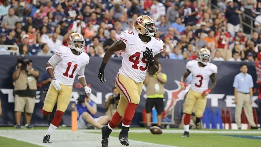 HOUSTON, TX- AUGUST 28: Asante Cleveland #45 of the San Francisco 49ers celebrates his touchdown against the Houston Texans in the second quarter in a pre-season NFL game on August 28, 2014 at NRG Stadium in Houston, Texas. (Photo by Thomas B. Shea/Getty Images)