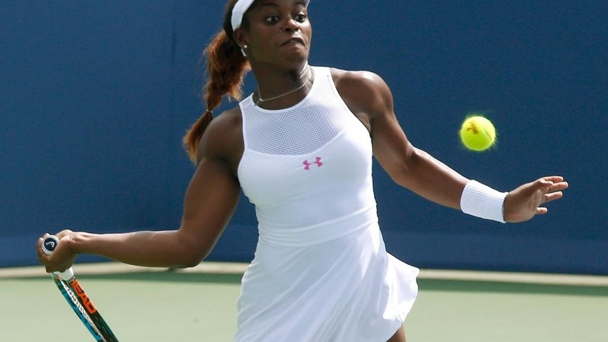 Sloane Stephens, of the United States, returns the ball to Carla Saurez Navarro, of Spain,during a first round match at the Western & Southern Open tennis tournament, Tuesday, Aug. 18, 2015, in Mason, Ohio. (AP Photo/David Kohl)