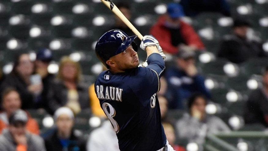 Monday, April 20: Milwaukee Brewers right fielder Ryan Braun hits a solo home run in the ninth inning against the Cincinnati Reds at Miller Park. The Brewers lost 6-1.