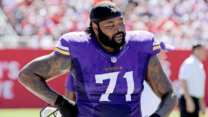 Oct 26, 2014; Tampa, FL, USA; Minnesota Vikings tackle Phil Loadholt (71) walks on the sidelines against the Tampa Bay Buccaneers at Raymond James Stadium. Mandatory Credit: David Manning-USA TODAY Sports