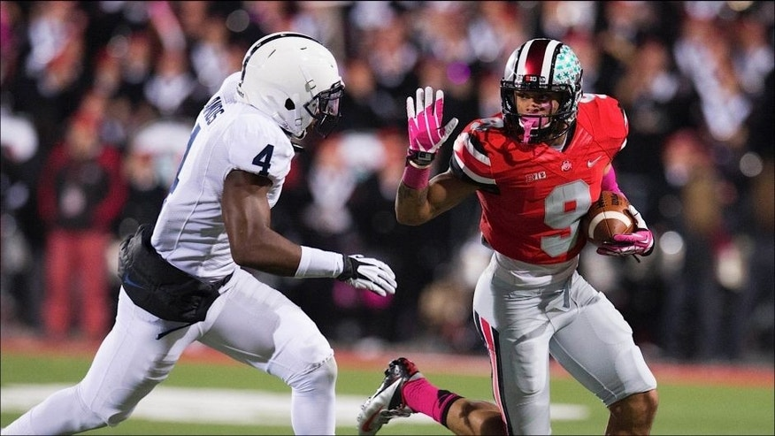 <p>Oct 26, 2013; Columbus, OH, USA; Ohio State Buckeyes wide receiver Devin Smith (9) runs the ball against Penn State Nittany Lions safety Adrian Amos (4) at Ohio Stadium. Ohio State won the game 63-14. Mandatory Credit: Greg Bartram-USA TODAY Sports</p>