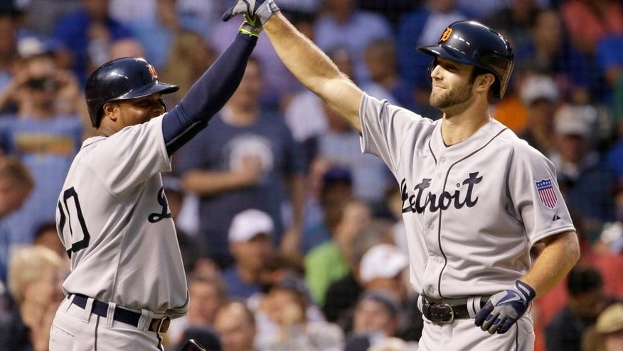 Detroit Tigers' Daniel Norris, right, celebrates with Rajai Davis after hitting a two-run home run against the Chicago Cubs during the second inning of a baseball game Wednesday, Aug. 19, 2015, in Chicago. (AP Photo/Nam Y. Huh)