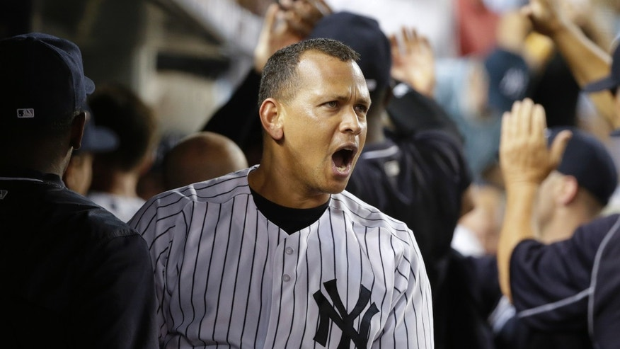 New York Yankees' Alex Rodriguez reacts while celebrating with teammates after hitting a grand slam during the seventh inning of a baseball game against the Minnesota Twins on Tuesday, Aug. 18, 2015, in New York. (AP Photo/Frank Franklin II)