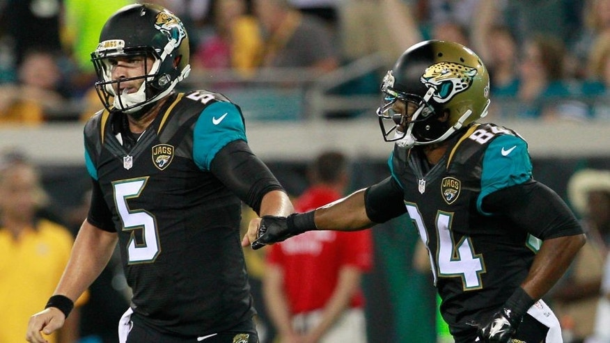 Aug 14, 2015; Jacksonville, FL, USA; Jacksonville Jaguars quarterback Blake Bortles (5) celebrates a touchdown with wide receiver Tony Washington (84) during the first half of a preseason NFL football game against the Pittsburgh Steelers at EverBank Field. Mandatory Credit: Reinhold Matay-USA TODAY Sports