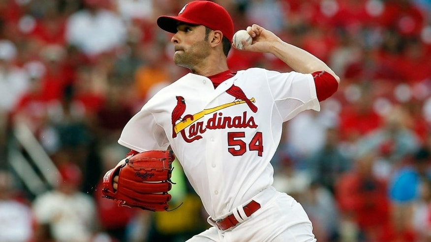 St. Louis Cardinals starting pitcher Jaime Garcia throws during the first inning of a baseball game against the Cincinnati Reds Tuesday, July 28, 2015, in St. Louis. (AP Photo/Scott Kane)