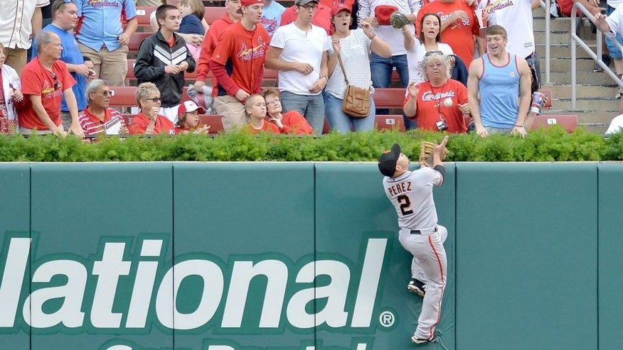 ST. LOUIS, MO - AUGUST 19: Juan Perez #2 of the San Francisco Giants makes a leaping catch at the wall in the first inning against the St. Louis Cardinals at Busch Stadium on August 19, 2015 in St. Louis, Missouri. (Photo by Michael Thomas/Getty Images)