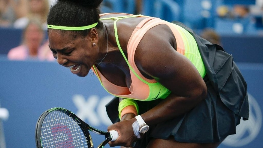 Serena Williams, of the United States, reacts during a match against Tsvetana Pironkova, of Bulgaria, at the Western & Southern Open tennis tournament, Wednesday, Aug. 19, 2015, in Mason, Ohio. (AP Photo/John Minchillo)