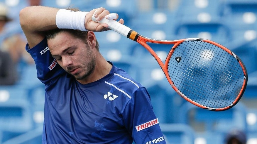 Stanislas Wawrinka, of Switzerland, wipes sweat from his forehead during his match against Borna Coric, of Croatia, at the Western & Southern Open tennis tournament, Wednesday, Aug. 19, 2015, in Mason, Ohio. (AP Photo/John Minchillo)