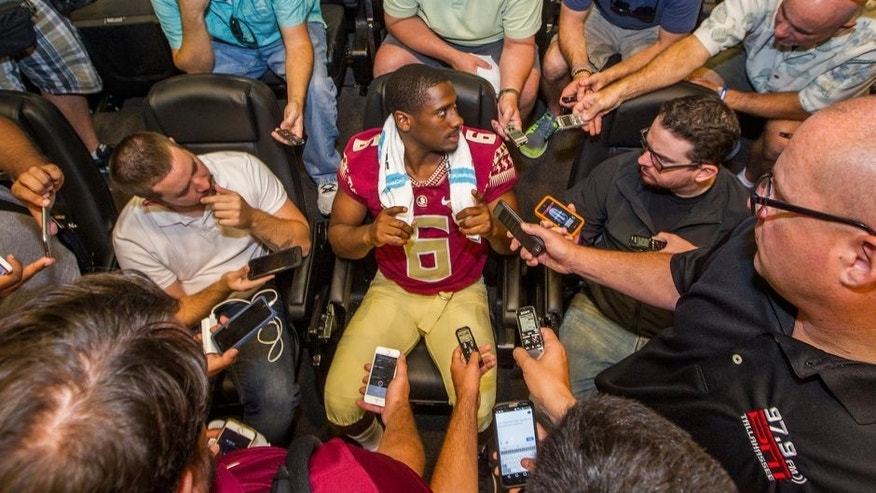 Florida State quarterback Everett Golson, center, talks during NCAA college football media day in Tallahassee, Fla., Sunday, Aug. 9, 2015. (AP Photo/Mark Wallheiser)