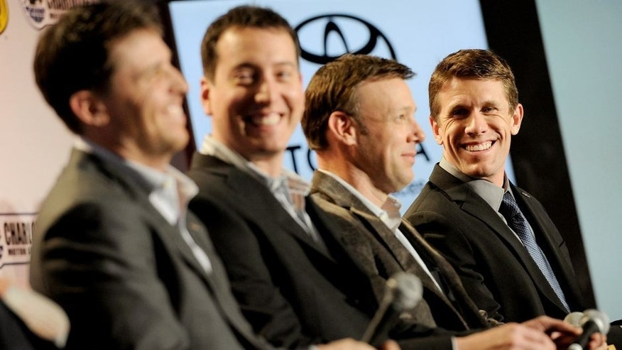 CHARLOTTE, NC - JANUARY 26: (R-L) Drivers Carl Edwards, Matt Kenseth, Kyle Busch, and Denny Hamlin look on during the NASCAR Sprint Media Tour at the Charlotte Convention Center on January 26, 2015 in Charlotte, North Carolina. (Photo by Jared C. Tilton/NASCAR via Getty Images)