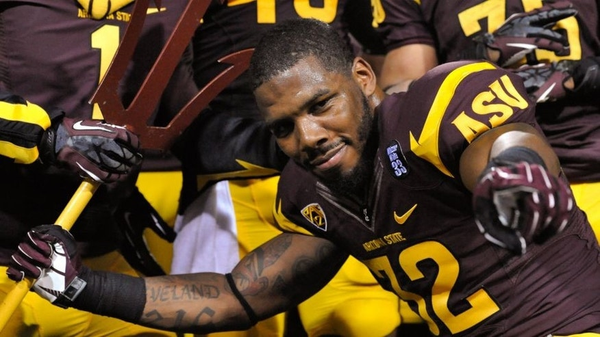 Oct 12, 2013; Tempe, AZ, USA; Arizona State Sun Devils linebacker Antonio Longino (32) celebrates after the fourth quarter against the Colorado Buffaloes at Sun Devil Stadium. The Sun Devils beat the Buffaloes 54-13. Mandatory Credit: Casey Sapio-USA TODAY Sports
