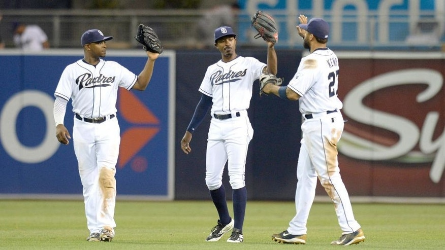 Aug 17, 2015; San Diego, CA, USA; San Diego Padres left fielder Justin Upton (let), center fielder Melvin Upton Jr. (center) and right fielder Matt Kemp (27) celebrate after the Padres beat the Atlanta Braves 5-3 at Petco Park. Mandatory Credit: Jake Roth-USA TODAY Sports