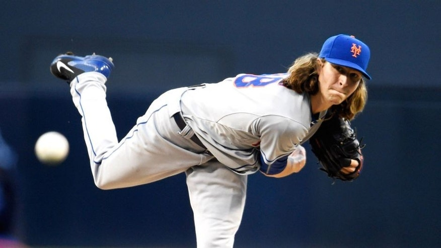 SAN DIEGO, CA - JUNE 1: Jacob deGrom #48 of the New York Mets pitches during the first inning of a baseball game against the San Diego Padres at Petco Park June 1, 2015 in San Diego, California. (Photo by Denis Poroy/Getty Images)